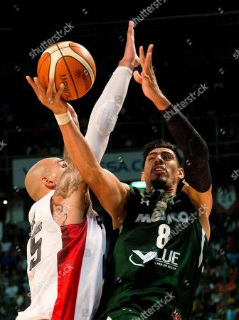 Gustavo Ayon, Robert Sacre Mexico's Gustavo Ayon, right, goes for a shot over Canada's Robert Sacre during their FIBA Americas Championship third place basketball game in Mexico City