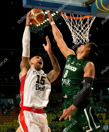Stock Image of Robert Sacre, Gustavo Ayon Canada's Robert Sacre goes for a shot over Mexico's Gustavo Ayon during their FIBA Americas Championship third place basketball game in Mexico City