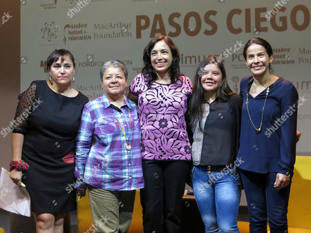 "Diana Damian, Carolina Gutierrez, Maria Ines Roque, Ana Isabel Guadarrama, Arcelia Ramirez Diana Damian, from left, of the organization Formacion y Capacitacion, Carolina Gutierrez of Red Mesoamericana Mujeres, Maria Ines Roque, film director, Ana Isabel Guadarrama, film director, and actress Arcelia Ramirez, pose for a portrait during the presentation of the documentary, ""Pasos Ciegos."" The film directed by Roque and Guadarrama presents migrant women from Central America telling their experiences in Mexico and the US"