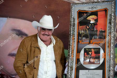 "Vicente Fernandez Mexico's ""King of Ranchera"" Vicente Fernandez poses for photographers during a news conference in Tlajomulco de Zuniga, Mexico, . The ranchera music icon unveiled his new album, ""Muriendo de Amor"
