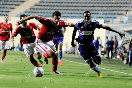 Saad Samir, Mahmoud Maarouf Al Ahly's Saad Samir, left, and Zamalek's Mahmoud Maarouf go after the ball during their Egyptian Cup soccer match at the Petrosport Stadium in Cairo, Egypt