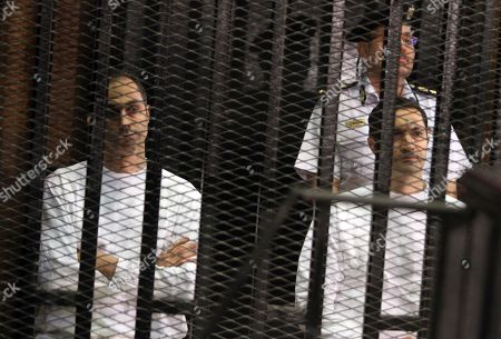 Gamal Mubarak, Alaa Mubarak Gamal Mubarak, left, and his brother Alaa Mubarak, sons of ousted Egyptian President Hosni Mubarak, listens to court proceedings from the defendants' cage in a courtroom in Cairo, Egypt. An Egyptian court, has ordered the release of the sons of deposed autocrat Hosni Mubarak, Gamal, Mubarak's one-time heir apparent, and his brother Alaa, a wealthy businessman, after time served on a corruption conviction
