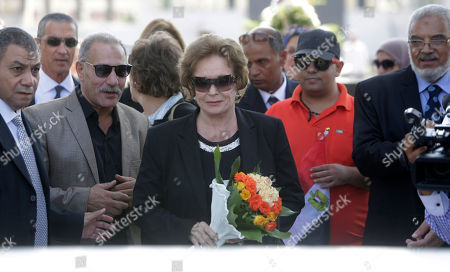 Jehan Sadat, widow of assassinated Egyptian president Anwar Sadat, lays a wreath at his tomb inside the memorial of the Unknown Soldier in Cairo, Egypt, marking the 42th anniversary of the Oct. 6 Arab-Israeli war in 1973. Egyptians marked the 42th anniversary of the Oct. 6 Arab-Israeli war when Egypt and Syria took advantage of the Jewish Yom Kippur holiday to launch surprise attacks on territories occupied by Israel in previous conflicts. It ended with a truce that led to the return of Egypt's Sinai Peninsula and a peace treaty between Egypt and Israel in 1979