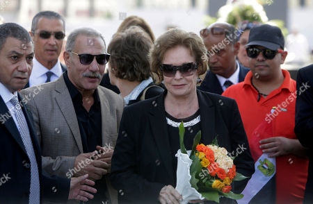 Jehan Sadat, widow of assassinated Egyptian President Anwar Sadat, lays a wreath at his tomb inside the memorial of the Unknown Soldier in Cairo, Egypt . Egyptians marked the 42th anniversary of the Oct. 6 Arab-Israeli war when Egypt and Syria took advantage of the Jewish Yom Kippur holiday to launch surprise attacks on territories occupied by Israel in previous conflicts. It ended with a truce that led to the return of Egypt's Sinai Peninsula and a peace treaty between Egypt and Israel in 1979