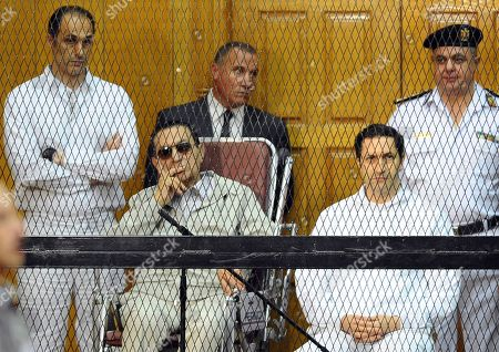 Hosni Mubarak, Gamal Mubarak, Alaa Mubarak Former Egyptian President Hosni Mubarak, seated center left, and his two sons, Gamal Mubarak, left, and Alaa Mubarak attend a hearing in a courtroom in Cairo, Egypt. An Egyptian court, has ordered the release of the sons of deposed autocrat Hosni Mubarak, Gamal, Mubarak's one-time heir apparent, and his brother Alaa, a wealthy businessman, after time served on a corruption conviction. Their father remains held in a military hospital