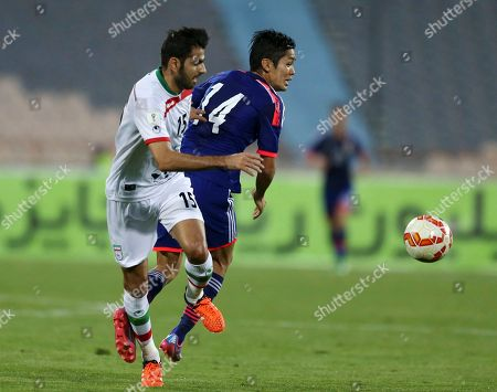 Pejman Montazeri, Yoshinori Muto Japan's national soccer team player Yoshinori Muto, right, vies for the ball with Iran's Pejman Montazeri during their friendly soccer match at the Azadi stadium in Tehran, Iran