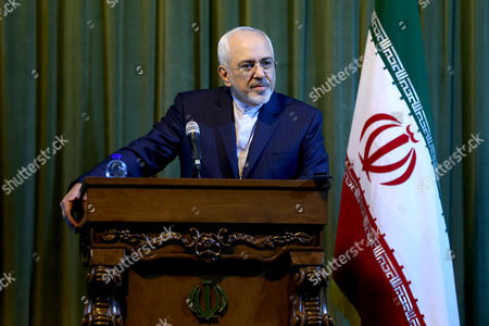 Stock Image of Javad Zarif Iranian Foreign Minister Mohammad Javad Zarif listens to a question during a press conference with his German counterpart Frank-Walter Steinmeier in Tehran, Iran. Iran says it will attend the upcoming international talks over Syria's future this week in Vienna. State TV quoted Foreign Ministry spokeswoman, Marzieh Afkham, on Wednesday, Oct. 28, 2015 as saying Foreign Minister Mohammad Javad Zarif will attend the talks