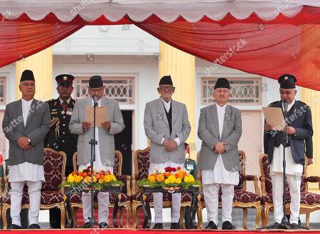Ram Baran Yadav, Khadga Prasad Oli Nepal's President Ram Baran Yadav, second left, administers the oath of office to newly elected Prime Minister Khadga Prasad Oli, right, at the Presidential building in Kathmandu, Nepal, . Nepal's new prime minister took the oath of office Monday and appointed the leaders of groups that are protesting the new constitution as his deputies