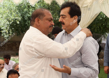 A man comforts Pakistan's former Prime Minister Yousuf Raza Gillani, right, who lost his nephew in a crush during the Hajj pilgrimage in Saudi Arabia, in Multan, Pakistan. As the hajj religious pilgrims entered its final day Saturday, officials in Saudi Arabia continued to grapple with the aftermath of a deadly stampede that killed at least 719 people