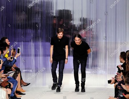 French fashion designer Alexis Martial, right, and creative director Adrien Caillaudaud acknowledge applause after the presentation of Carven's spring-summer 2016 ready-to-wear collection presented during the Paris Fashion Week, in Paris, France