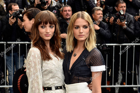 Stock Photo of Australian singers Miranda, left, and Elektra Kilbey of the group Say Lou Lou arrive at Chanel' Spring-Summer 2016 ready-to-wear fashion collection presented during the Paris Fashion Week, in Paris, France