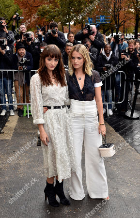 Australian singers Miranda, left, and Elektra Kilbey of the group Say Lou Lou arrive at Chanel' Spring-Summer 2016 ready-to-wear fashion collection presented during the Paris Fashion Week, in Paris, France
