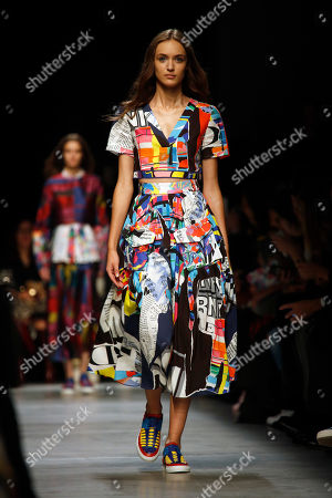 A model wears a creation by French fashion designer Yiqing Yin for the Leonard Paris fashion house as part of its Spring-Summer 2016 ready-to-wear fashion collection, presented during the Paris Fashion Week in Paris, France