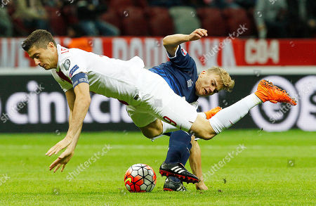 Robert Lewandowski,Coombes Poland's Robert Lewandowski, front, and Gibraltar's James Coombes fight for the ball during the Euro 2016 Group D qualifying soccer match between Poland and Gibraltar at the National Stadium in Warsaw,Poland