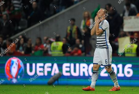 Denmark's Lars Jacobsen reacts at the end of the Euro 2016 qualifying group I soccer match between Portugal and Denmark at the Municipal Stadium in Braga, Portugal, . Portugal defeated Denmark 1-0