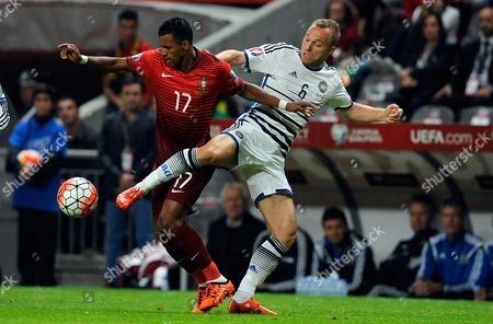 Portugal's Nani, left, fights for the ball with Denmark's Lars Jacobsen during the Euro 2016 qualifying group I soccer match between Portugal and Denmark at the Municipal Stadium in Braga, Portugal