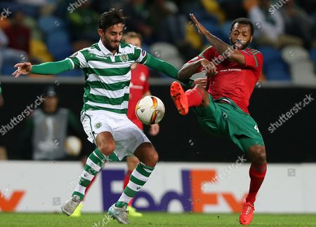 Sporting's Alberto Aquilani, left, vies for the ball with Lokomotiv's Manuel Fernandes during the Europa League group H soccer match between Sporting CP and Lokomotiv Moscow at the Alvalade stadium in Lisbon