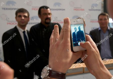 Steven Seagal People photograph themselves with U.S. actor Steven Seagal, while attending an opening ceremony for a research and development center in Moscow, Russia, on . Steven Seagal is in Moscow as a brand innovations 'ambassador' of a Russian IT company
