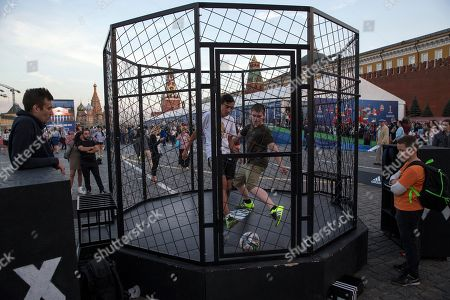 Children play soccer in Red Square, with St. Basil Cathedral and Kremlin's Spassky Tower at left back, after the ceremony marking 1,000 days to the 2018 World Cup in Moscow, Russia, . Russia marked 1,000 days to go until the 2018 World Cup on Friday, but FIFA Secretary General Jerome Valcke was absent after being suspended from his duties