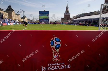 Children play soccer at a soccer park installed in Red Square, with Kremlin's Spassky Tower at the back, after the ceremony marking 1,000 days to the 2018 World Cup in Moscow, Russia, . Russia marked 1,000 days to go until the 2018 World Cup on Friday, but FIFA Secretary General Jerome Valcke was absent after being suspended from his duties