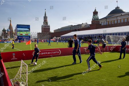 Children play soccer at a soccer park installed in Red Square, with St. Basil Cathedral and Kremlin's Spassky Tower at back left, after the ceremony marking 1,000 days to the 2018 World Cup in Moscow, Russia, . Russia marked 1,000 days to go until the 2018 World Cup on Friday, but FIFA Secretary General Jerome Valcke was absent after being suspended from his duties