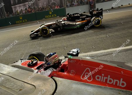 Manor driver Will Stevens of Britain prepares to exit his car after crashing during the second practice session at the Singapore Formula One Grand Prix on the Marina Bay City Circuit in Singapore