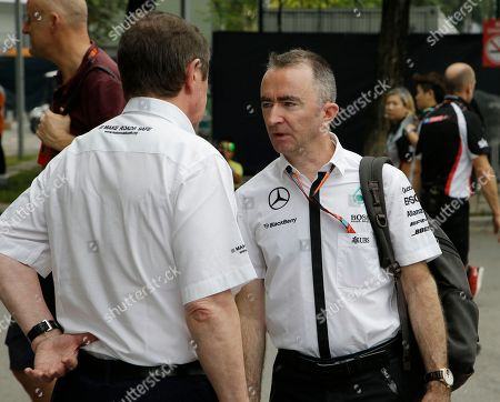 Paddy Lowe, right, Mercedes Technical Executive Director talks with a teammate in the F1 paddock at the Marina Bay City Circuit ahead of the Singapore Formula One Grand Prix in Singapore