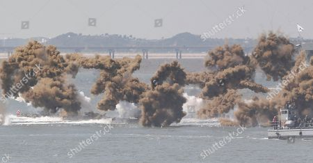 Stock Picture of South Korean Marine amphibious assault vehicles sail to shores in a smoke screens during the 65th Incheon Landing Operations Commemoration ceremony in waters off Incheon, South Korea, . Incheon is the coastal city where the United Nations Forces led by U.S. General Douglas MacArthur landed in September, 1950 just months after North Korea invaded the South