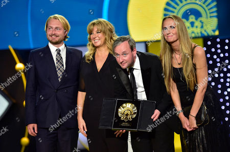 Iceland film director, Runar Runarsson, second right, gestures after receiving the Golden Shell for the best film with ''Sparrows'', at 63rd San Sebastian Film Festival, in San Sebastian, northern Spain