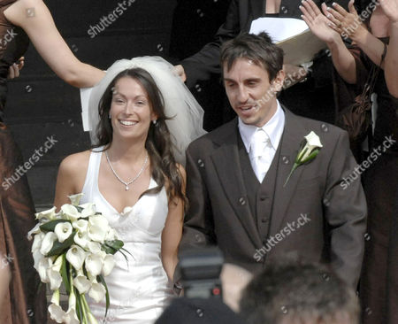 Stock Picture of Gary and Emma Neville on the Cathedral steps after their wedding service.