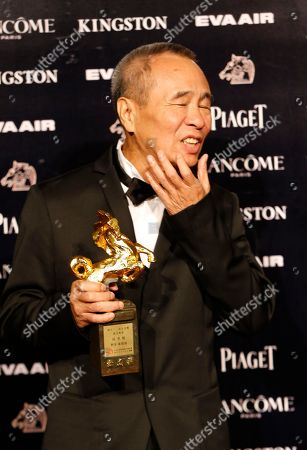 """Hou Hsiao-hsien Taiwanese director Hou Hsiao-hsien holds his award for Best Director at the 52nd Golden Horse Awards in Taipei, Taiwan, . Hou won for the film """"The Assassin"""" at this year's Golden Horse Awards, one of the Chinese-language film industry's biggest annual events"""