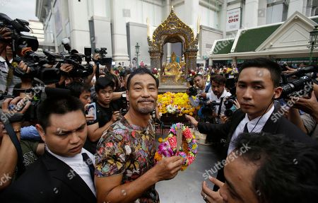 Simon Yam Hong Kong actor Simon Yam holds a garland and sticks of incense to make an offering for Phra Phrom, the Thai interpretation of the Hindu god Brahma at the Erawan Shrine in Bangkok, Thailand, . Thailand is making special efforts to promote tourism after the Aug. 17 bombing at the shrine
