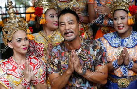 Simon Yam Hong Kong actor Simon Yam poses for photographer with Thai classical dancers at the Erawan Shrine in Bangkok, Thailand, . Thailand is making special efforts to promote tourism after the Aug. 17 bombing at the shrine