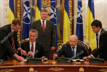 Petro Poroshenko, Jens Stoltenberg,Oleksandr Turchynov Oleksandr Turchynov, Secretary of the National Security and Defence Council of Ukraine, second from right, and NATO Secretary General Jens Stoltenberg, second from left, take part in a signing ceremony of bilateral documents in Kiev, Ukraine