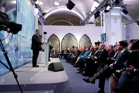 """Ukrainian President Petro Poroshenko, left, speaking during the 12th Annual Meeting entitled """"At Risk: How New Ukraine's Fate Affects Europe and the World"""" organized by the Yalta European Strategy (YES) in partnership with the Victor Pinchuk Foundation at the Mystetsky Arsenal Art Center in Kiev, Ukraine, . More than 200 leaders from politics, business and society representing more than 20 countries will discuss major global challenges and their impact on Europe, Ukraine and the world"""