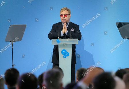 """Elton John Sir Elton John speaking during the 12th Annual Meeting entitled """"At Risk: How New Ukraine's Fate Affects Europe and the World"""" organized by the Yalta European Strategy (YES) in partnership with the Victor Pinchuk Foundation at the Mystetsky Arsenal Art Center in Kiev, Ukraine, . Sir Elton John delivered a keynote speech about the role of business in promoting human rights. More than 200 leaders from politics, business and society representing more than 20 countries will discuss major global challenges and their impact on Europe, Ukraine and the world"""