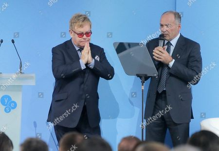 """Elton John, Viktor Pinchuk Sir Elton John, left, and Ukrainian tycoon and philanthropist Viktor Pinchuk during the 12th Annual Meeting entitled """"At Risk: How New Ukraine's Fate Affects Europe and the World"""" organized by the Yalta European Strategy (YES) in partnership with the Victor Pinchuk Foundation at the Mystetsky Arsenal Art Center in Kiev, Ukraine, . Sir Elton John delivered a keynote speech about the role of business in promoting human rights. More than 200 leaders from politics, business and society representing more than 20 countries will discuss major global challenges and their impact on Europe, Ukraine and the world"""