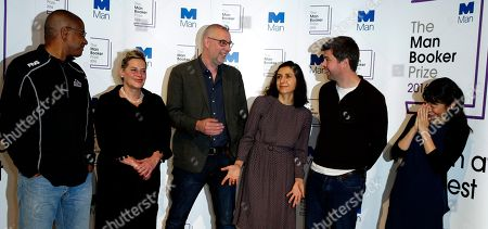 """The Man Booker prize short list writers pose for the media,they are from the left-Paul Beatty, """"The Sellout"""", Deborah Levy, """"Hot Milk"""" Graeme Macrae Burnet, """"His Bloody Project"""", Ottessa Moshfegh """"Eileen"""", David Szalay """"All That Man Is"""", and Madeleine Thien, """"Do Not Say We Have Nothing"""", during a photocall for the Mann Booker Prize for fiction in London,. This will be the third year the £50,000 (61,000 US$), prize has been open to any writer, writing originally in English and published in the UK, irrespective of nationality"""