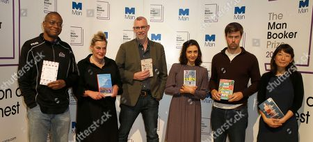 """The Man Booker prize short list writers pose for the media, with the books,they are from the left-Paul Beatty, """"The Sellout"""", Deborah Levy, """"Hot Milk"""" Graeme Macrae Burnet, """"His Bloody Project"""", Ottessa Moshfegh """"Eileen"""", David Szalay """"All That Man Is"""", and Madeleine Thien, """"Do Not Say We Have Nothing"""", during a photocall for the Man Booker Prize for fiction in London,. This will be the third year the £50,000 (61,000 US$), prize has been open to any writer, writing originally in English and published in the UK, irrespective of nationality"""
