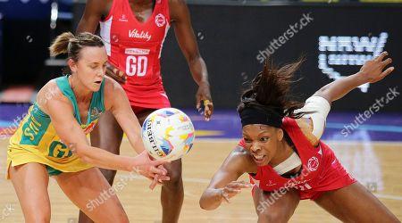 England's Eboni Beckford-Chambers, right, battles with Australia's Natalie Medhurst during their Netball World Cup in Sydney, Australia