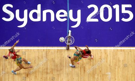 England's Pamela Cookey, right, and Australia's Julie Corletto, 2nd right, battle for the ball during their Netball World Cup in Sydney, Australia
