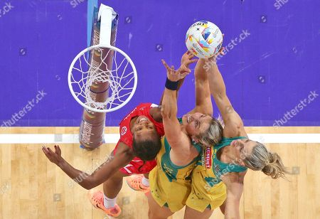 England's Pamela Cookey, left, battles Australia's Julie Corletto, center, and Laura Geitz during their Netball World Cup in Sydney, Australia