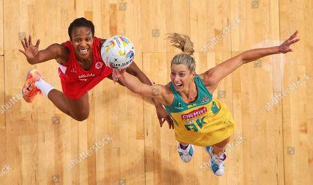 England's Pamela Cookey, left, battles with Australia's Laura Geitz during their Netball World Cup in Sydney, Australia