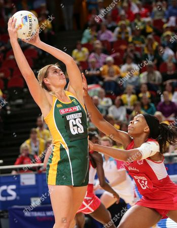 England's Eboni Beckford-Chambers, right, defends as South Africa's Lenize Potgieter catches the ball during the Netball World Cup in Sydney, Australia