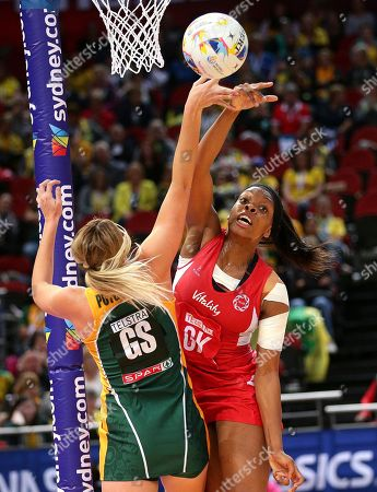 England's Eboni Beckford-Chambers, right, and South Africa's Lenize Potgieter battle for the ball during the Netball World Cup in Sydney, Australia