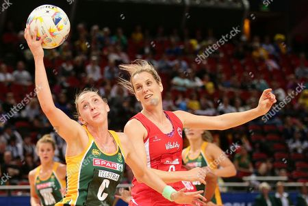 England's Sara Bayman, right, and South Africa's Erin Burger chase the ball during the Netball World Cup in Sydney, Australia
