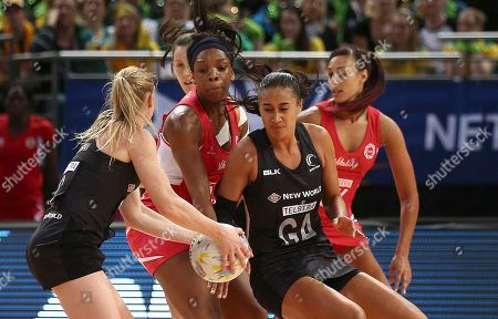 New Zealand's Laura Langman, left, goes for a pass to Maria Tutaia as England's Eboni Beckford-Chambers, second from left, and Geva Mentor defend them during their Netball World Cup semifinal match in Sydney