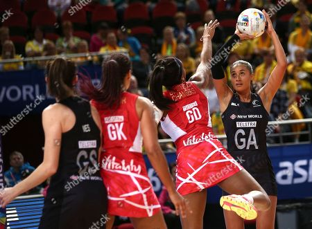Stock Picture of New Zealand's Maria Tutaia, right, prepares to shoot as England's Eboni Beckford-Chambers, second from right, tries to block her during their Netball World Cup semifinal match in Sydney, Australia