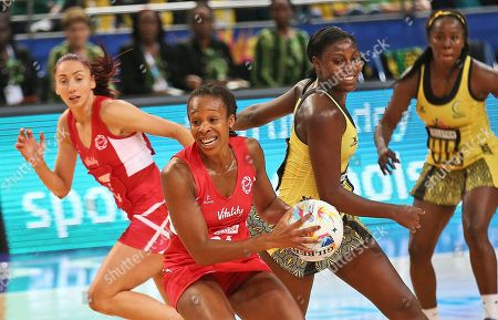 Stock Image of Pamela Cookey England's Pamela Cookey, center, takes the ball during their Netball World Cup bronze medal match against Jamaica in Sydney