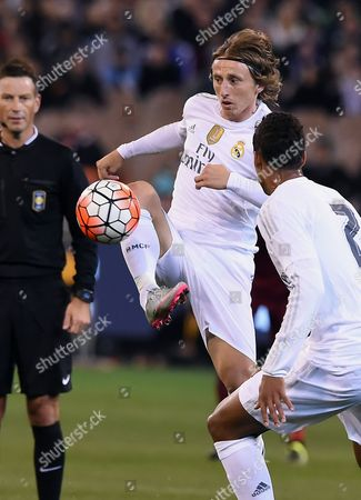 Real Madrid's Carlos Casimiro, left kicks the ball while competing against AS Roma during their International Championship Cup soccer match in Melbourne, Australia